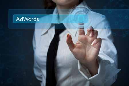 adwords: Business, technology, internet and networking concept. Business woman presses a button on the virtual screen: AdWords