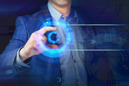 A businessman working on modern futuristic technology. 版權商用圖片