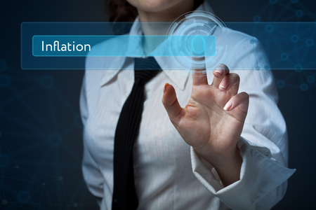 Business, technology, internet and networking concept. Business woman presses a button on the virtual screen:  Inflation Imagens