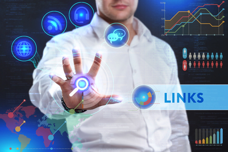 reverse: Business, Technology, Internet and network concept. Business man working on the tablet of the future, select on the virtual display: LINKS