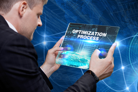 systems operations: Business Technology Internet and network concept. Technology future. Young businessman working on the smartphone of the future clicks on the virtual display button: Optimization