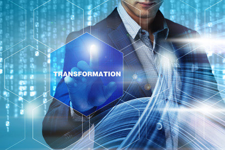 Business internet technology concept. Businessman chooses Transformation button on a touch screen interface. Stock Photo
