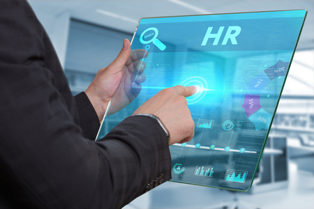 keywords link: Business, Technology, Internet and network concept. Business man working on the tablet of the future, select on the virtual display: HR