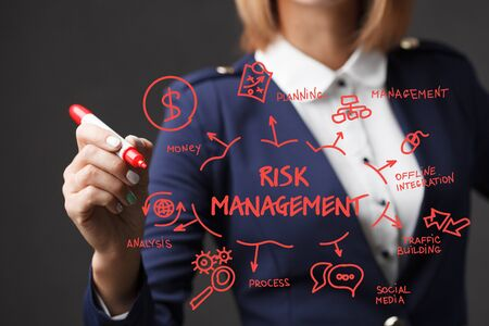 Business girl writes a red marker development strategy. The concept of marketing.Risk management Stock Photo