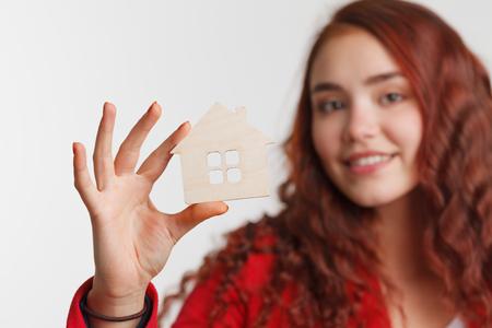 reside: Portrait Young woman Estate agent. Mortgage concept
