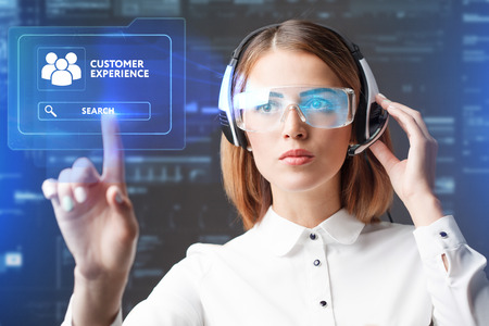 Young businesswoman working in virtual glasses, select the icon customer experience on the virtual display.