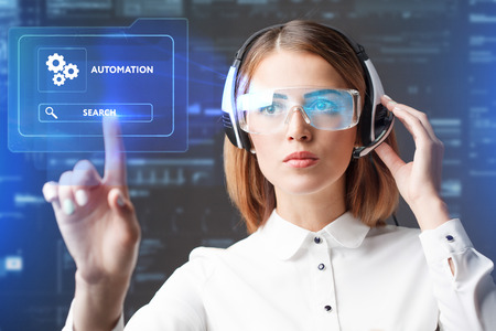 algorithms: Young businesswoman working in virtual glasses, select the icon automation on the virtual display. Stock Photo