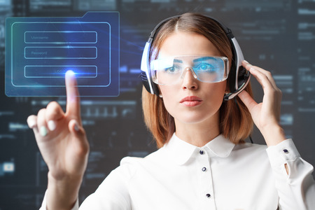 Young businesswoman working in virtual glasses, select the icon on the virtual display