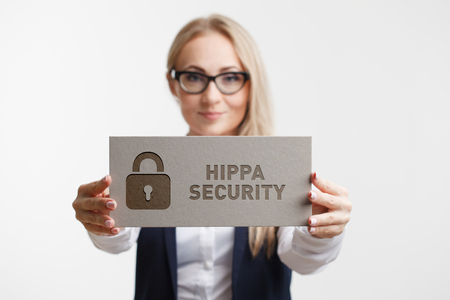 Business, Technology, Internet and network concept. Young girl holding a sign with an inscription Hippa Security.