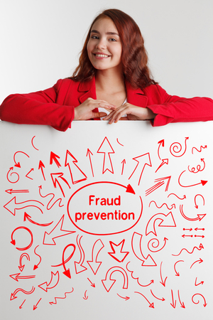 questions: Technology, internet, business and marketing. Young business woman writing word: Fraud prevention Stock Photo