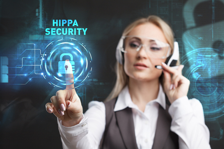 criminal: Young businesswoman working in virtual glasses, select the icon Hippa Security on the virtual display