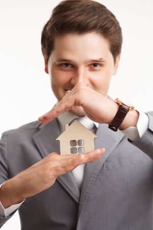 residence: Portrait Young male Estate agent. Mortgage concept. Stock Photo