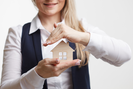 Property insurance and security concept.Real estate agent offer house Stock Photo