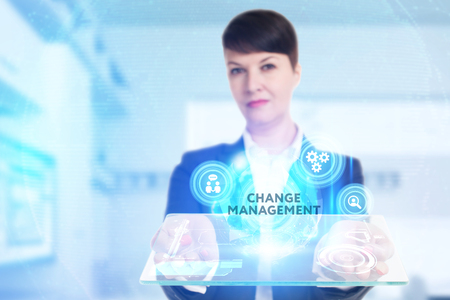 The concept of business, technology, the Internet and the network. A young entrepreneur working on a virtual screen of the future and sees the inscription: Change management Imagens