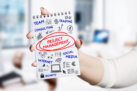 Technology, internet, business and marketing. Young business woman writing word: Project management Imagens