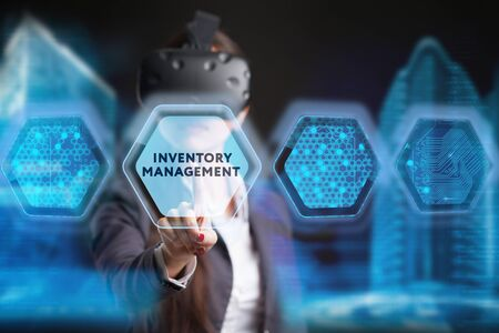 The concept of business, technology, the Internet and the network. A young entrepreneur working on a virtual screen of the future and sees the inscription: Inventory management Imagens