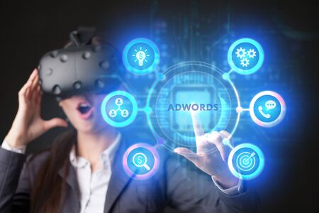 The concept of business, technology, the Internet and the network. A young entrepreneur working on a virtual screen of the future and sees the inscription: AdWords Imagens