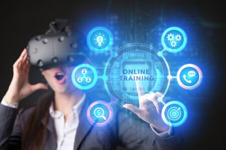 The concept of business, technology, the Internet and the network. A young entrepreneur working on a virtual screen of the future and sees the inscription: Online training Imagens