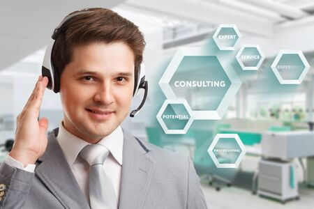Consulting business concept. Businessman presses text Consulting on virtual screen.