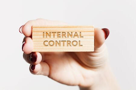 The concept of business, technology, the Internet and the network. Young businessman showing inscription: Internal control.