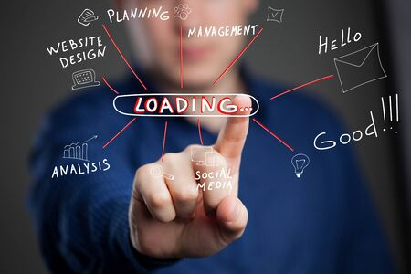 The concept of business, technology, the Internet and the network. A young entrepreneur working on a virtual screen of the future and sees the inscription: Loading