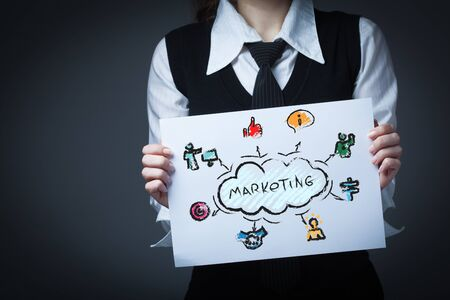Planning marketing strategy. Business, Technology, Internet and network concept. Young businessman shows the word: Marketing