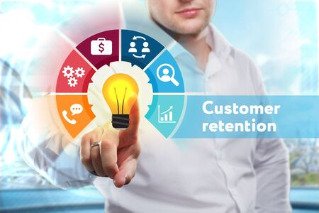 Business, Technology, Internet and network concept. Young businessman shows the word: Customer retention