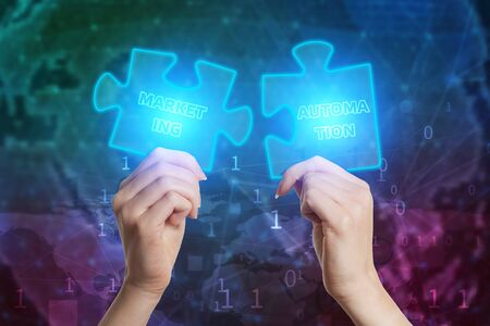 The concept of business, technology, the Internet and the network. Business solutions, success and strategy concept. Businessman hand connecting jigsaw puzzle. Marketing automation