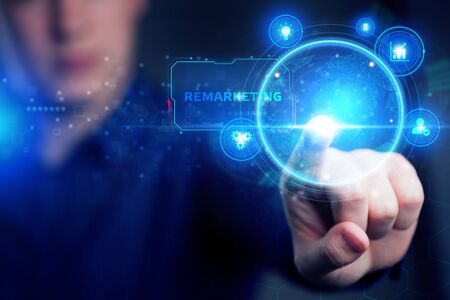 Planning marketing strategy. Business, Technology, Internet and network concept. Young businessman shows the word: Remarketing