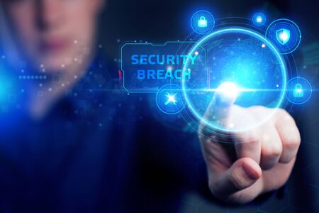 Cyber security data protection business technology privacy concept. Young businessman working in the office, select the icon security on the virtual display. Security breach