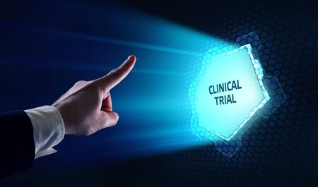 Business, Technology, Internet and network concept. Business man working on the tablet of the future, select on the virtual display: Clinical trial Banco de Imagens