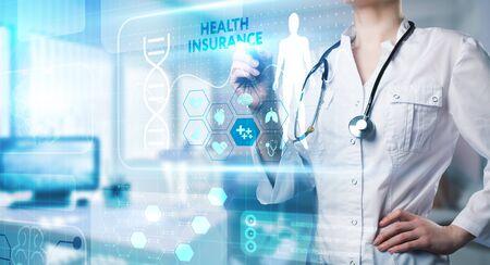 Modern technology in healthcare, medical diagnosis. HEALTH INSURANCE sign on virtual screen. Foto de archivo