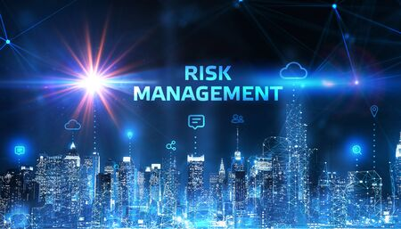 Business, Technology, Internet and network concept. Young businessman shows the word on the virtual display of the future: Risk management