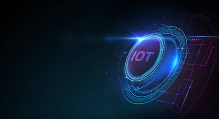 Internet of things - IOT concept. Businessman offer IOT products and solutions. Young businessman select the abstract chip with text IoT on the virtual display.