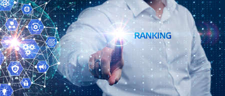 Business, Technology, Internet and network concept. Young businessman working on a virtual screen of the future and sees the inscription: Ranking