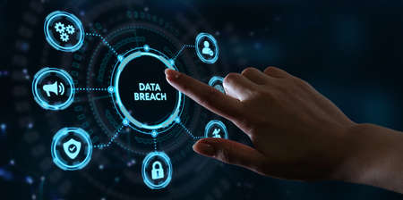 Business, technology, internet and networking concept. Young businessman working on his laptop in the office, select the icon Data breach on the virtual display.