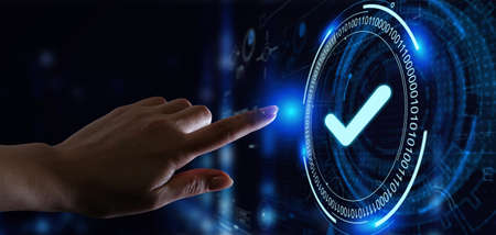 Standard quality control. Certification. Business, technology, internet and networking concept. Young businessman select the icon on the virtual display. Stock Photo