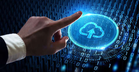 Cloud computing concept. Business, technology, internet and networking concept. Young businessman select the icon Cloud on the virtual display.