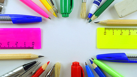 entries: pens, pencils and rulers lined circle on a white background