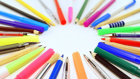 entries: pens, pencils, brushes and pens lined circle
