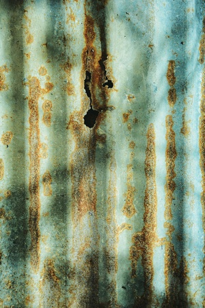 Pattern of rust on decaying zinc sheet