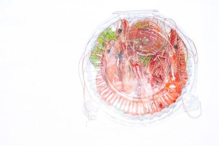 Prawns in white background on plastic bowl.. Select focus.