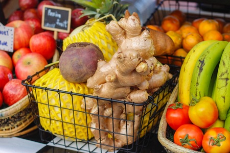 Ginger,melon,apple, Beetroot, tomatoes and mango on the wood and black basket at the market in Thailand. Select focus.