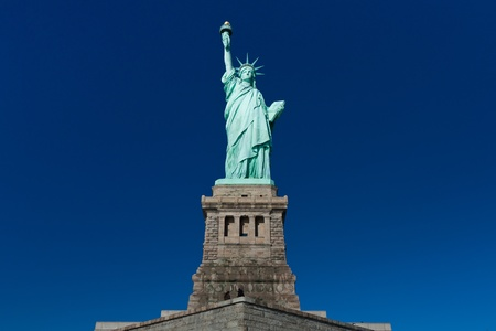 Statue of Liberty on clear blue sky, New York photo