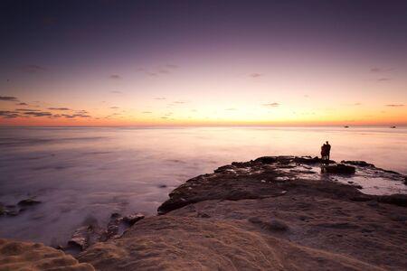 la: Sunset with silhouette of couple at La Jolla Cove, La Jolla, California