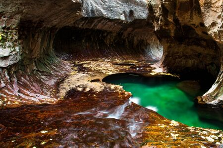 zion: Green pond in the cave from the subways, Zion National Park Stock Photo