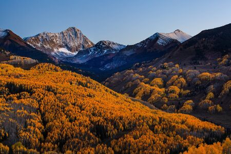 capital of colorado: Sunset at Capital Peak with the yellow aspen forest, Aspen, Colorado