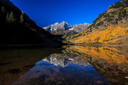 Reflection at Maroon Bells with Fall color in the morning
