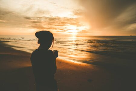 reflection of life: Defocused woman on the beach sunrise.