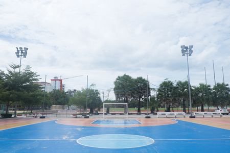 football play: Futsal field in a public outdoor park.